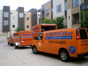Fleet Of Water Mitigation Vehicles At A Commercial Job Site